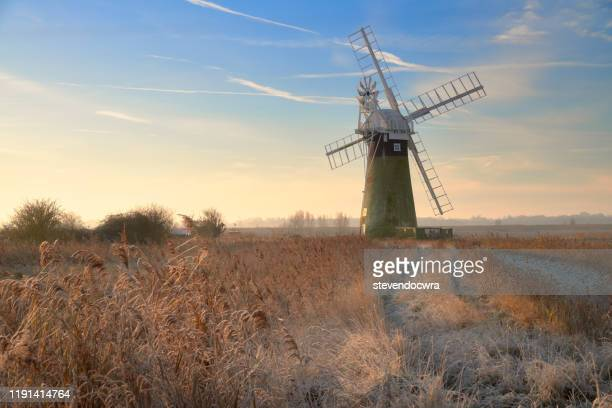 st benet's level windmill on a cold and frosty december morning - rural scene stock pictures, royalty-free photos & images
