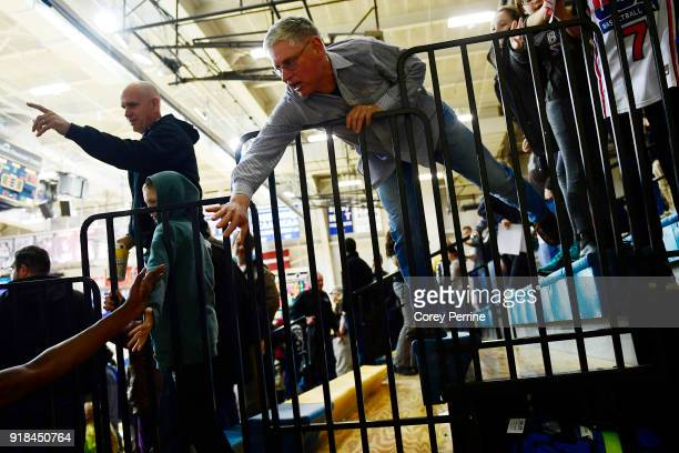 St Bonaventure Bonnies fan highfives teammates after the win over the La Salle Explorers at Tom Gola Arena on February 13 2018 in Philadelphia...