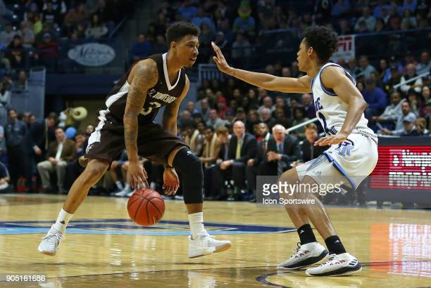 St Bonaventure Bonnies guard Jaylen Adams defended by Rhode Island Rams guard Jeff Dowtin during a college basketball game between St Bonaventure...