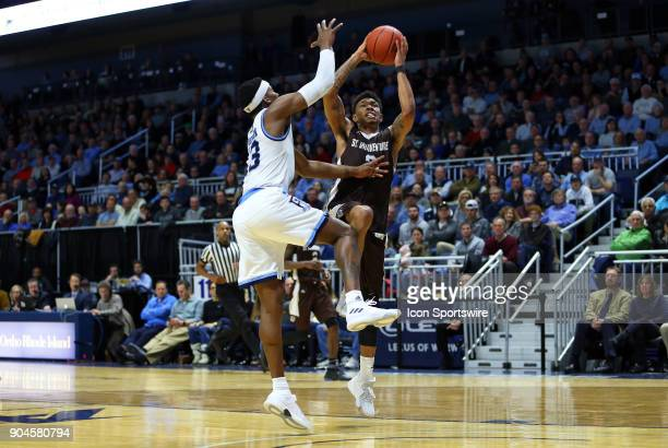 St Bonaventure Bonnies guard Jaylen Adams drives to the basket defended by Rhode Island Rams guard Stanford Robinson during a college basketball game...