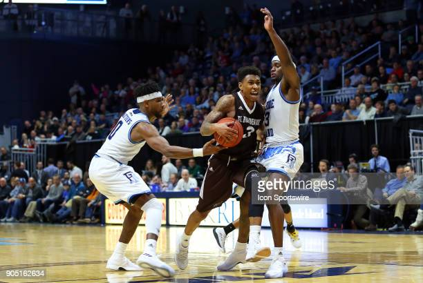 St Bonaventure Bonnies guard Jaylen Adams drives to the basket defended by Rhode Island Rams guard EC Matthews and Rhode Island Rams guard Stanford...