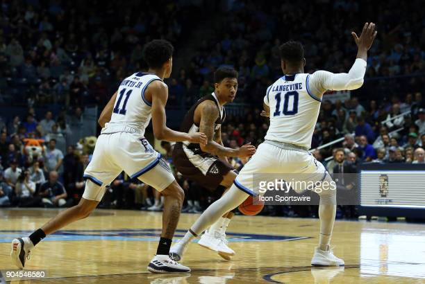 St Bonaventure Bonnies guard Jaylen Adams is doubledteamed by Rhode Island Rams guard Jeff Dowtin and Rhode Island Rams forward Cyril Langevine...