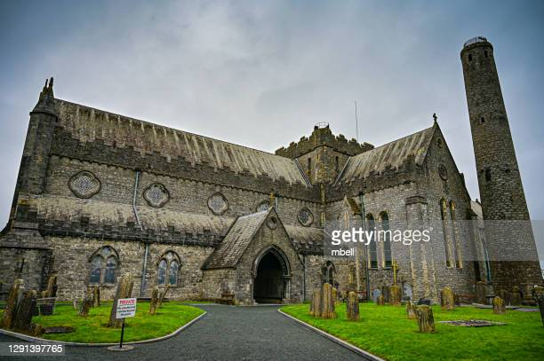 st canice's cathedral and round tower - kilkenny ireland - catholicism stock pictures, royalty-free photos & images