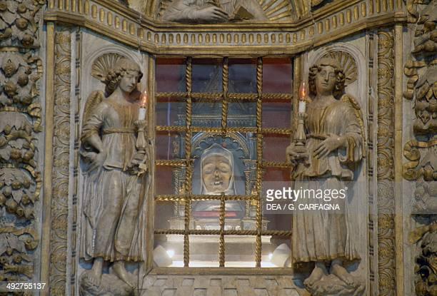 St Catherine of Siena's incorrupt head marble altar by Giovanni di Stefano interior of the Basilica of San Domenico historic centre of Siena Tuscany...