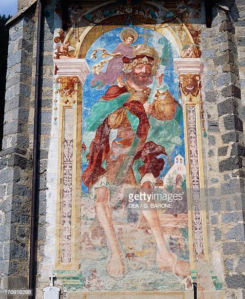 St Christopher, fresco on the external wall of the Parish Church of San Sigismondo, Kiens , Val Pusteria, Trentino-Alto Adige, Italy.