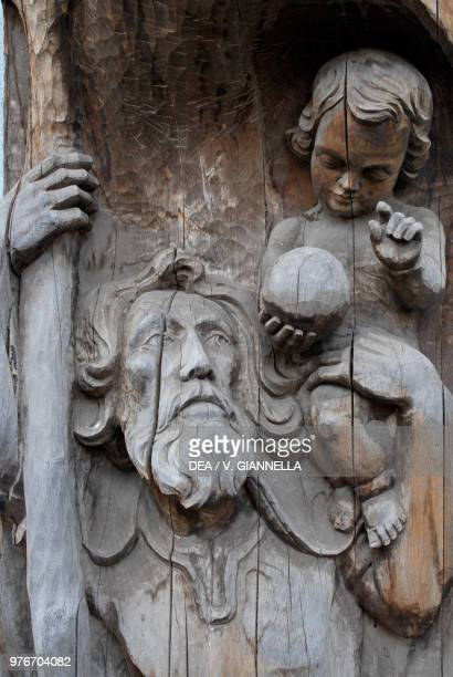 St Christopher, wood sculpture created by a local craftsman, Canazei, Val di Fassa, Trentino-Alto Adige, Italy.