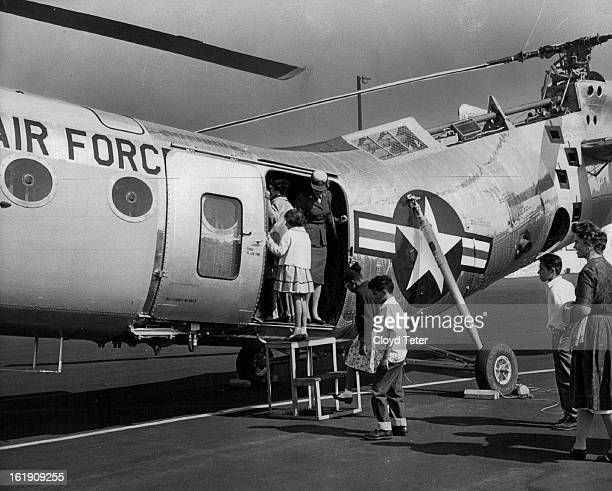 SEP 22 1962 SEP 23 1962 St Clara's Orphanage Youngsters from St Clara's Orphanage got a closeup look Saturday at the interior of an H21B helicopter...