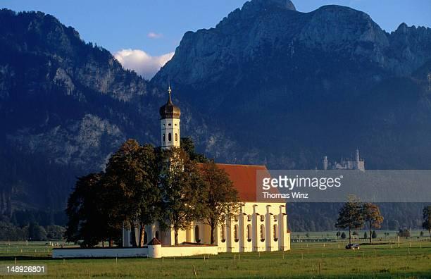 St Coloman Church with Neuschwanstein castle in background.
