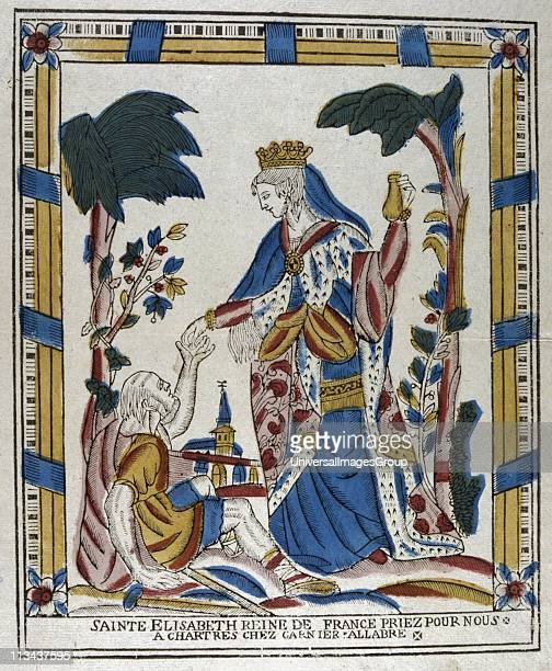 St Elizabeth of Hungary giving alms to a beggar. After the death of her husband Louis IV, Landgrave of Thuringia, Germany from plague while on...