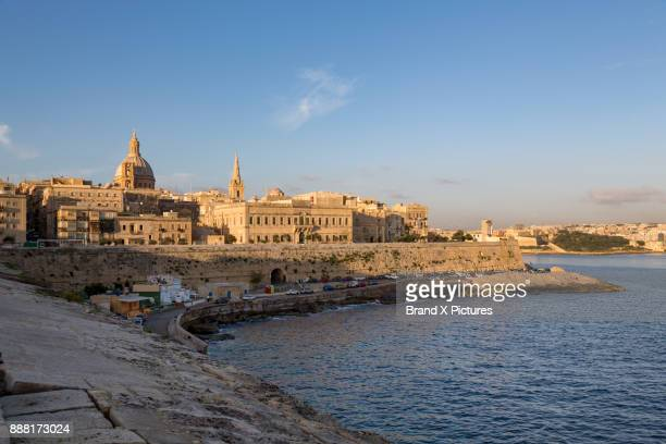 st. elmo bay, the dome of our lady of mount carmel and the spire of st. pauls anglican cathedral, valletta - bay of water stock pictures, royalty-free photos & images