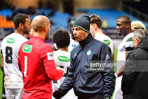 St Etienne goalkeeping coach Fabrice Grange offers advice to Jessy Moulin of St Etienne before the penalty shootout during the French National Cup...