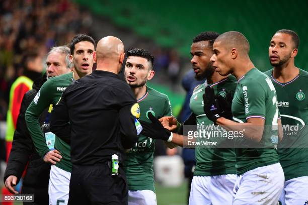 St Etienne players lead by Remy Cabella protest to referee Amaury Delerue after their captain is sent off during the Ligue 1 match between AS...