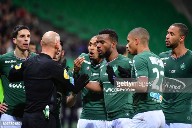 St Etienne players protest to referee Amaury Delerue after their captain is sent off during the Ligue 1 match between AS SaintEtienne and AS Monaco...