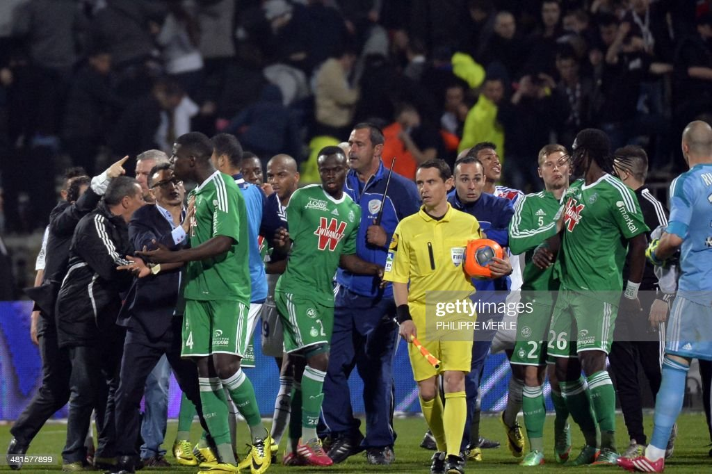 St Etienne's and Lyon's players scuffle during the French L1 football match Olympique Lyonnais (OL) vs Saint-Etienne (ASSE) at the Gerland stadium in Lyon, southeastern France, on March 30, 2014.