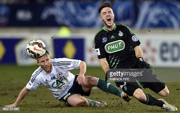 St Etienne's Dutch forward Ricky Van Wolfswinkel is tackled by Red Star's defender Julien Ielsch on February 10 2015 during a French Cup match Red...