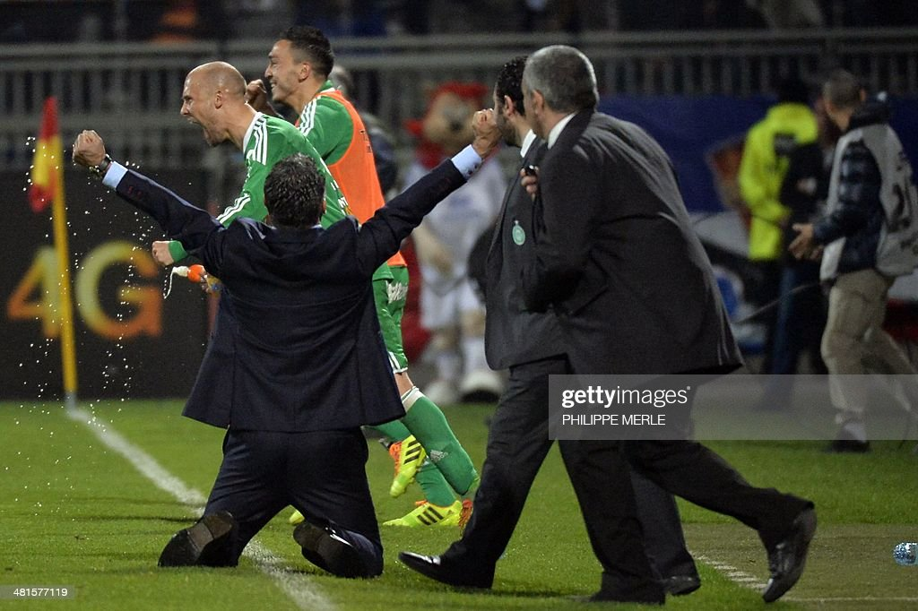 St Etienne's French coach Christophe Galtier (L) reacts with players and staff members after Saint Etienne defeated Lyon 2-1 in their French L1 football match Olympique Lyonnais (OL) vs Saint-Etienne (ASSE) at the Gerland stadium in Lyon, southeastern France, on March 30, 2014.