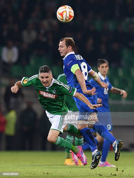 St Etienne's French midfielder Fabien Lemoine vies for the ball withDnipro's Ukrainian forward Roman Zozulya during the Europa League football match...