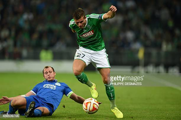 St Etienne's French midfielder Franck Tabanou vies with Dnipro's Ukrainian forward Roman Zozulya during the Europa League football match AS...