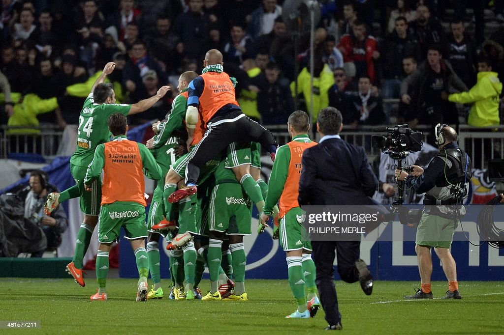 St Etienne's players celebrate after they defeated Lyon 2-1 in their French L1 football match Olympique Lyonnais (OL) vs Saint-Etienne (ASSE) at the Gerland stadium in Lyon, southeastern France, on March 30, 2014.