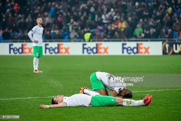 TOPSHOT St Etienne's players look dejected after they lost their UEFA Europa League round of 32 second leg football match against FC Basel and at the...