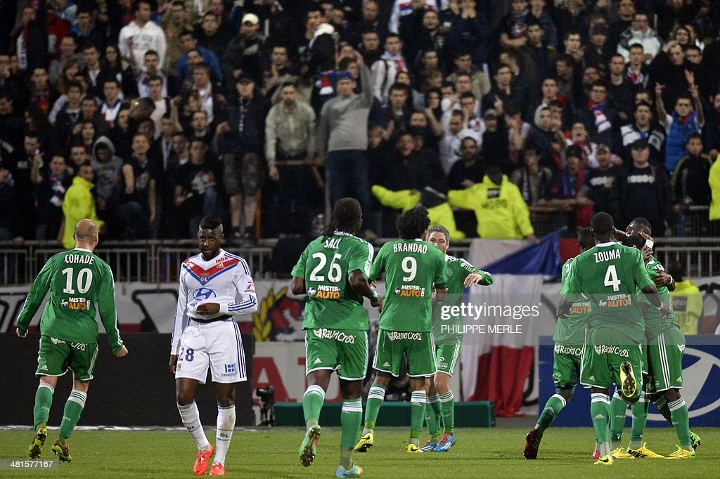 St Etienne's players react after they defeated Lyon 2-1 in their French L1 football match Olympique Lyonnais (OL) vs Saint-Etienne (ASSE) at the Gerland stadium in Lyon, southeastern France, on March 30, 2014.