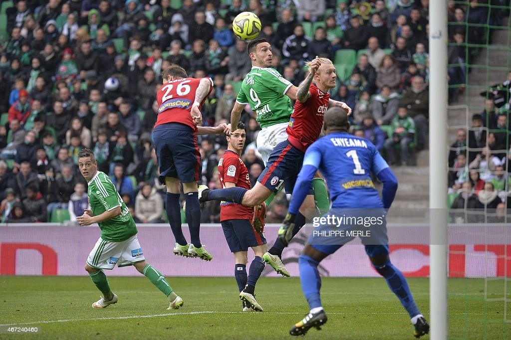 St Etienne's Turkish forward Mevlut Erding (C) and Lille's Danish defender Simon Kjaer (2nd R) go for a header during the French L1 football match Saint-Etienne (ASSE) vs Lille (LOSC) on March 22, 2015 at the Geoffroy-Guichard stadium in Saint-Etienne.