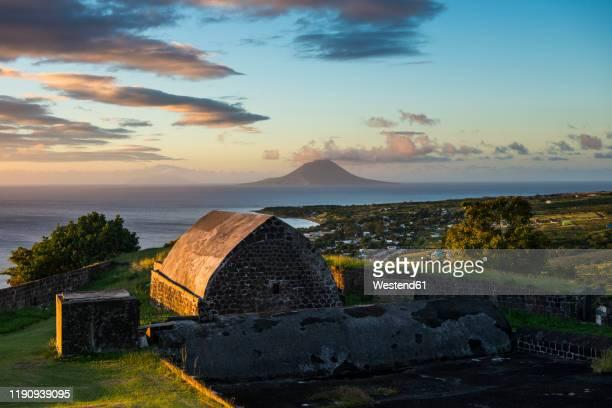 st. eustatius seen from brimstone hill fortress, st. kitts and nevis, caribbean - sint eustatius stockfoto's en -beelden