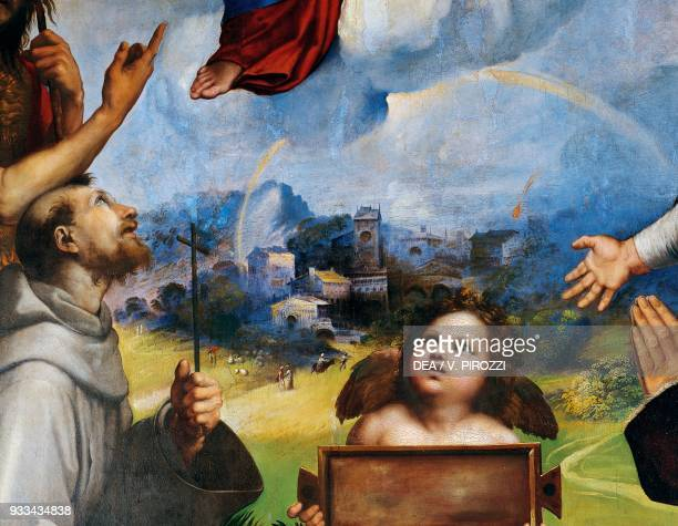 St Francis and an angel with a town in the background detail from the Madonna of Foligno 15111512 by Raphael oil on panel transferred to canvas...