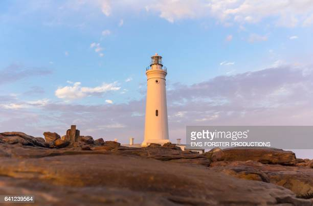 st francis bay lighthouse - shot-3: tower with rocks in foreground / during sunset - ems forster productions stock pictures, royalty-free photos & images