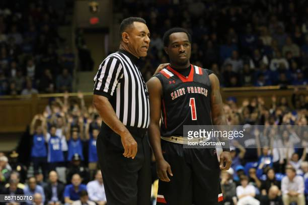St Francis Red Flash guard Malik Harmon and a referee during the 1st half of the Duke Blue Devils game versus the StFrancis on December 05 at Cameron...