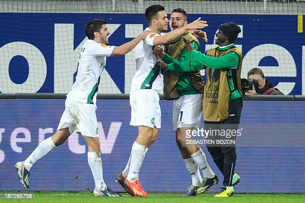 St Gallen's Swiss forward Goran Karanovic is congratulated after scoring a goal during the UEFA Europa League Group A football match between FC Saint...