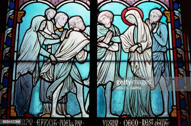 St Genevieve healing a blind man by Alfred Gerente stainedglass window in the sacristy of NotreDame cathedral 12th14th century Paris France