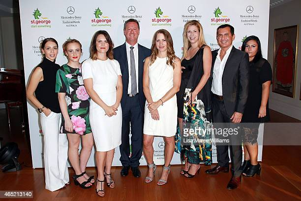 St George CEO George Frazis and HR Director Paul Harvey with designers Michelle Azanvorian Stacey Hendrickson Vanessa Moe Samantha Jones Annie...