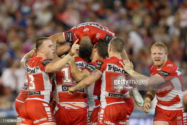 St George Illawarra Dragons celebrate the win during the round four NRL match between the Newcastle Knights and the St George Illawarra Dragons at...