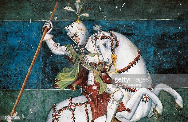 St George slaying the dragon fresco in the courtyard of Fenis Castle Valle d'Aosta Italy Detail