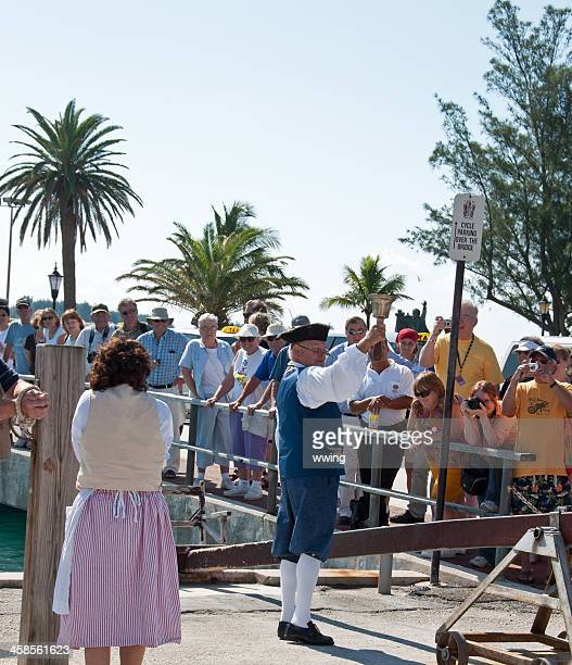 st. georges, bermuda, tourist demonstration - pillory stock photos and pictures