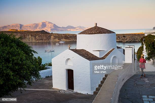 st george's chapel at the lindos, rhodes, greece. - lindos stock photos and pictures