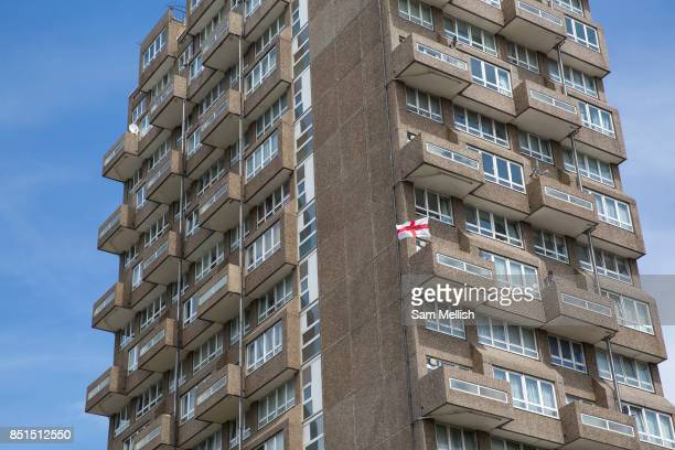 St Georges Cross flag blows in the wind from a balcony at Holland Rise House on 15th June 2016 in London, United Kingdom.