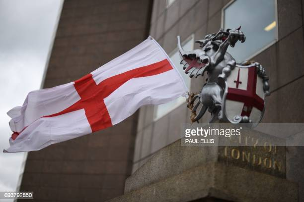A St George's Cross flag flies from a City of London boundary marker at the southern end of London Bridge in London on June 8 2017 following the June...