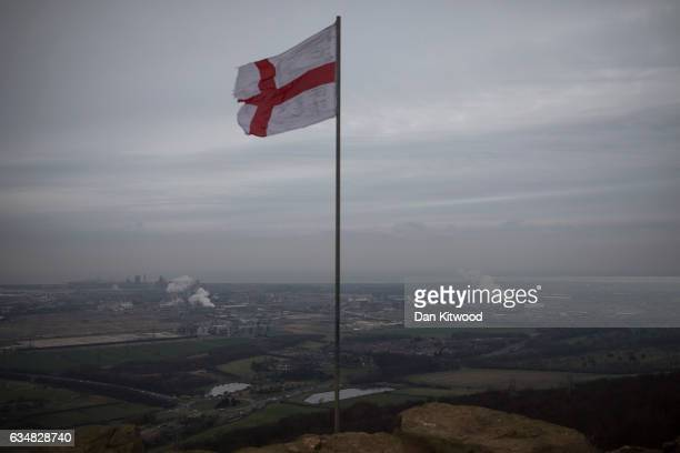 St Georges flag stands as a tribute to the murdered soldier Lee Rigby on top of Eston Nab in North Yorkshire which looks down at the view over the...