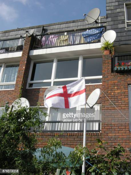 UK St Georges flags and satellite dishes in Clapton near the Olympic Park construction site in east London Photo © Julio Etchart CDREF00664