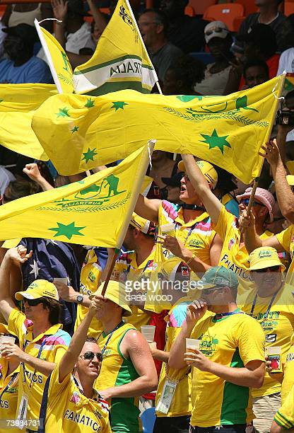 St George's GRENADA Australian fans provide a sea of yellow as they cheer on their team during the ICC World Cup Cricket Group Eight match against...