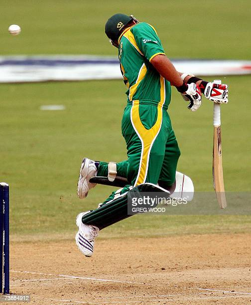 St. George's, GRENADA: South African batsman Jacques Kallis jumps in the air to avoid a bouncer from New Zealand's Shane Bond during their ICC...