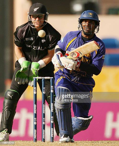 St George's GRENADA Sri Lankan cricketer Kumar Sangakkara plays a drive watched by New Zealand wicketkeeper Brendon McCullum during the ICC Cricket...