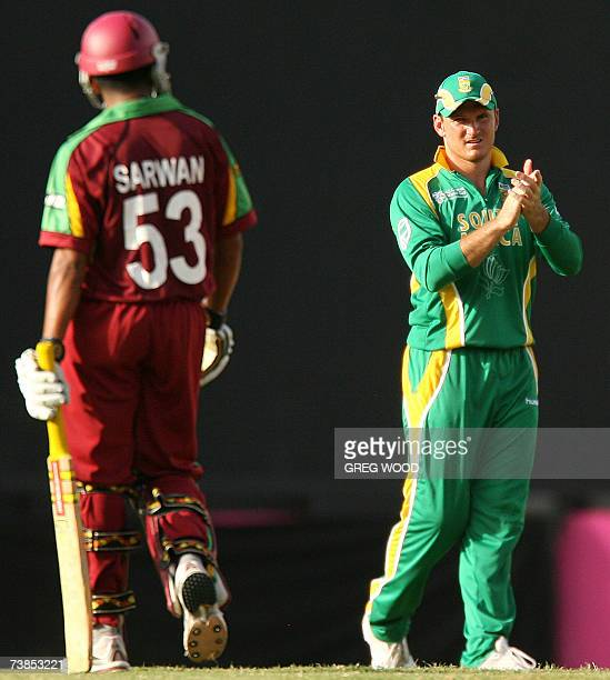 St George's GRENADA West Indies batsman Ramnaresh Sarwan is applauded by South African captain Graeme Smith as he leaves the field after being...