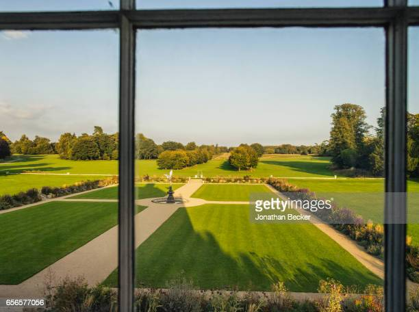 St Giles House is photographed on September 9 2015 in Dorset England A view from the South Drawing Room of the formal garden with the statue of...