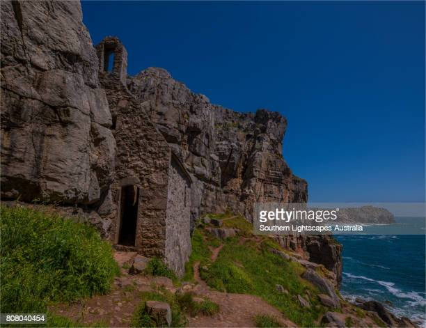 st. govan's head with the historic chapel and coastline, pembrokeshire, wales, united kingdom. - govan stock pictures, royalty-free photos & images