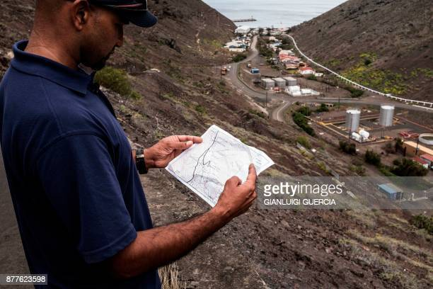 St Helena resident Alonzo Henry looks at a site map in Rupert's valley on October 19 where the skeletons of 325 former slaves were found near James...