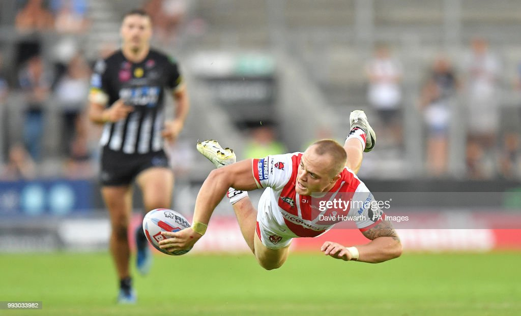 St Helens' Adam Swift hands off the ball during the Betfred Super League match at The Totally Wicked Stadium, St Helens.