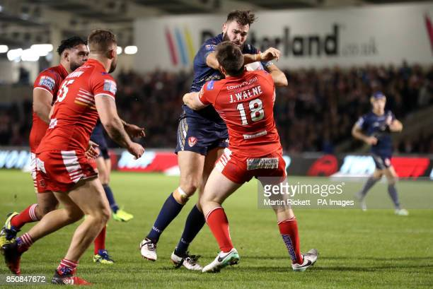 St Helens Alex Walmsley drives to the line past Salford Red Devils' Mason CatonBrown for a try during the Betfred Super 8s match at the AJ Bell...
